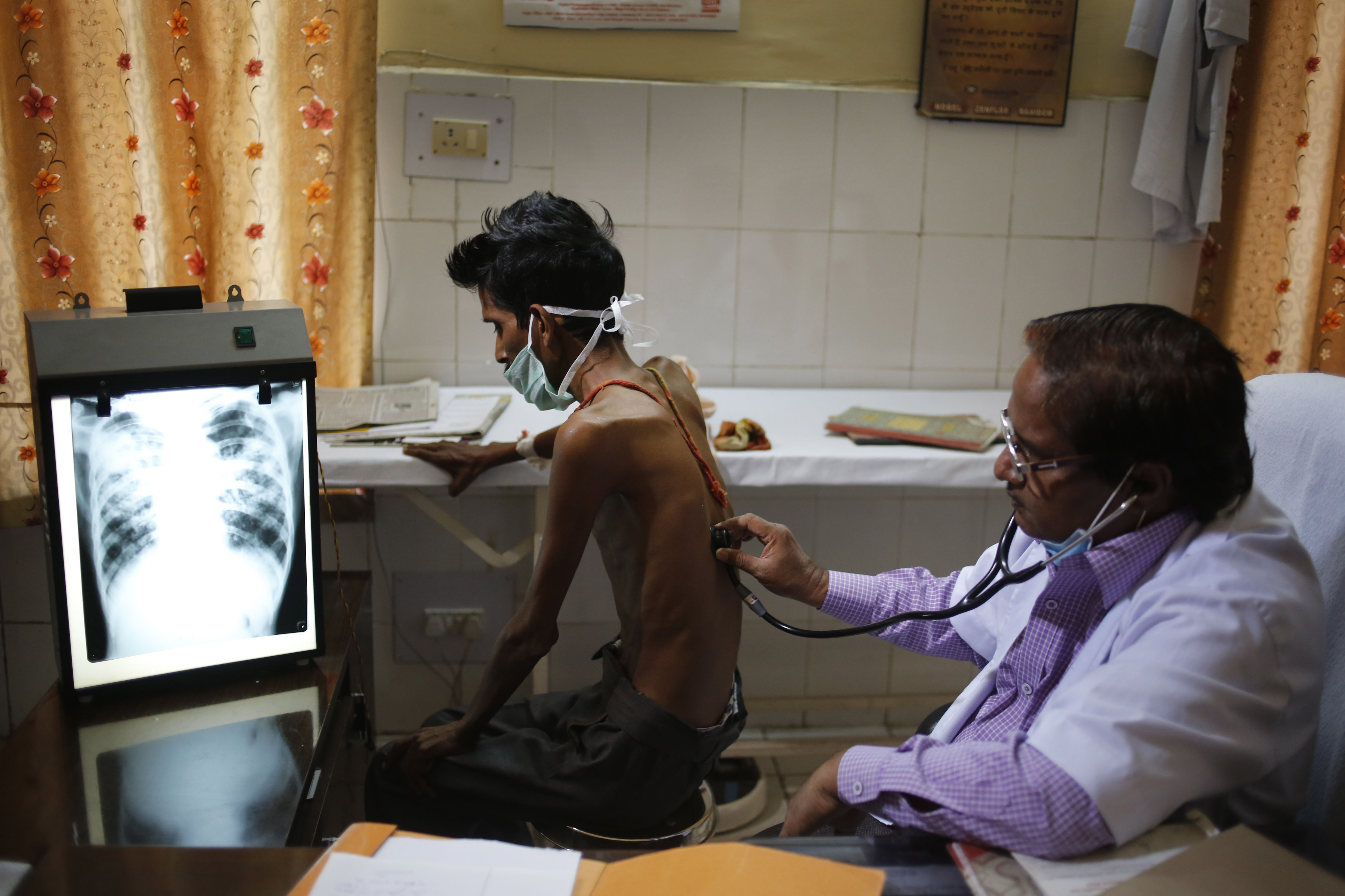 An Indian doctor examines a tuberculosis patient in a government TB hospital on World Tuberculosis Day in Allahabad, India, Monday, March 24, 2014. India has the highest incidence of TB in the world, according to the World Health Organization's Global Tuberculosis Report 2013, with as many as 2.4 million cases. India saw the greatest increase in multidrug-resistant TB between 2011 and 2012. The disease kills about 300,000 people every year in the country. (AP Photo/Rajesh Kumar Singh)